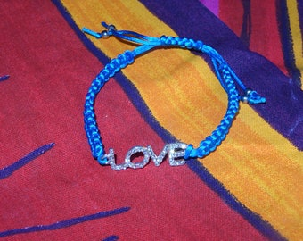 Blue bracelet and charm to teen and adult