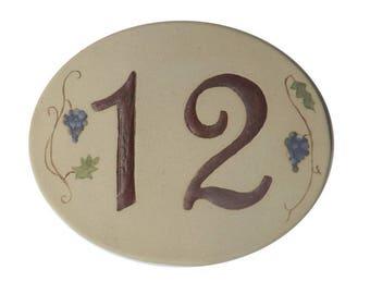 Original oval shaped, front door number, number 12 deco vine
