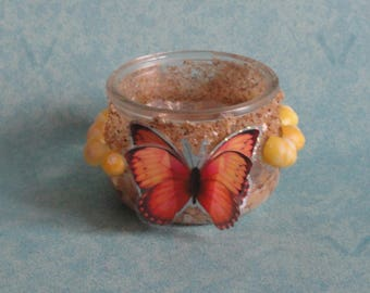 Candle glass butterflies, seashells and sand