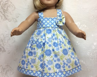 "Sundress designed to keep your doll cool.  Made to fit 18"" American Girl Doll."