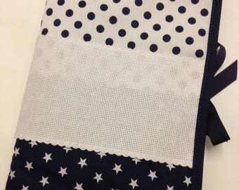 Health book has embroidery stitch crosses, stars and Navy Blue polka dots