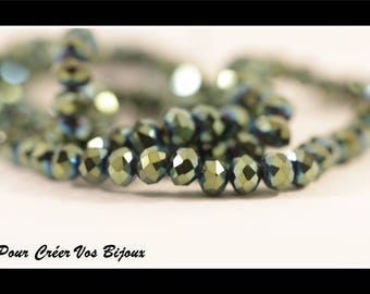 Set of 50 faceted beads in emerald green glass AB 6x4mm