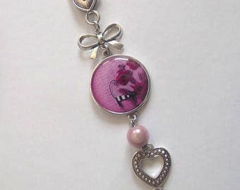 Keychain cabochon print black and white striped cat on a pink background with flowers, pink magic Pearl bow and heart charms and acrylic
