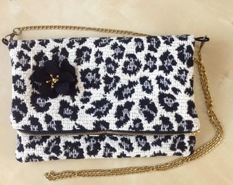 Clutch bag with flap, with black flower.