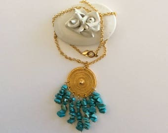 Turquoise chips on gold chain Locket pendant