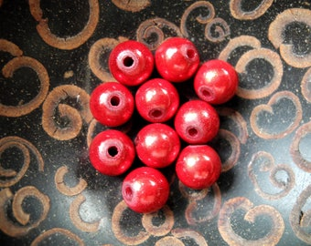 Set of 10 mm red magic pearls