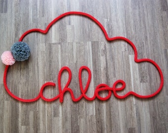 Word or name in large knitted form cloud + tassels