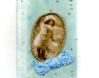 309 - Vintage greeting card girl in winter