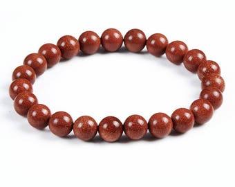 beautiful red color bracelet Golden glod sand beads