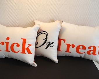 "Three pillows halloween ""trick or treat"" orange and black"