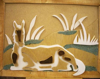 Wood, coated horse painting.