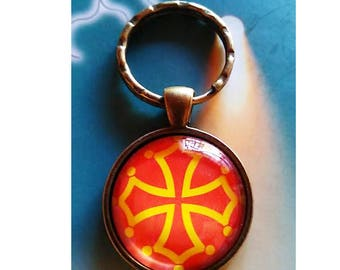A pretty Keychain with a glass cabochon 30 mm cross L'Occitane