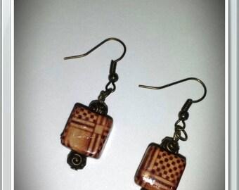 Earrings in bronze and Pearl
