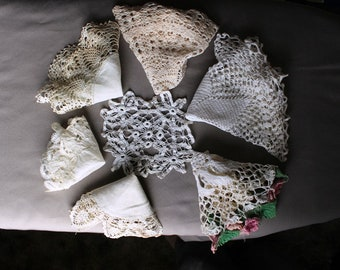 Seven vintage doilies, crocheted by hand