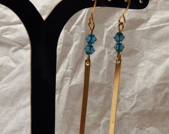 Pair of dangling beads and gold