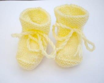 light yellow baby booties