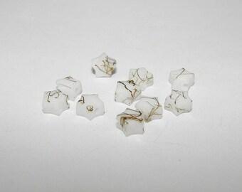 Set of 10 beads acrylic white star shape.