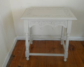 Ornate carved side table hand painted and distressed