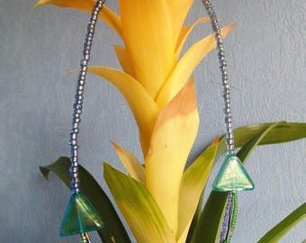 a short necklace in blue/green seed beads.