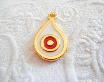 x 1 Teardrop evil eye gold tone and ivory and Red enamel charm pendant.