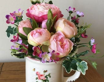 Pink Silk flowers in a Mug