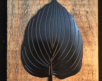 Metal Hosta leaf on reclaimed wood