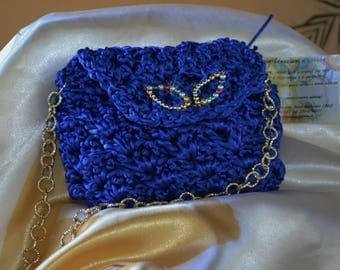 crochet electric blue clutch with golden chain