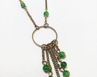 Bronze necklace, marbled green beads
