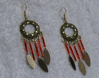 single earring with bronze color and seed beads
