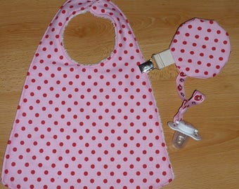 reversible pink bib with polka dots for girl