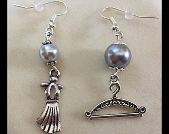 "Mismatched earrings ""dress on hanger"""
