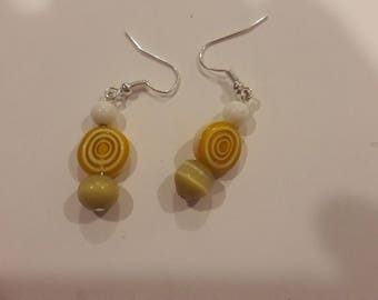 yellow swirls with white and brown beaded earrings