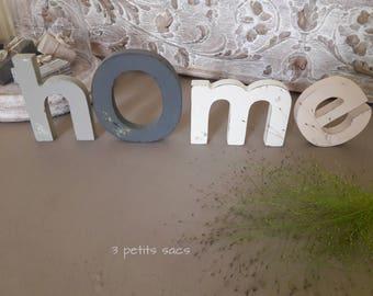 "Letters ""h.O.m.e.""  wood; Acrylic paint, matte, pink powder, white, charcoal and gray zinc"
