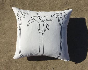 Embroidered palm tree pillow