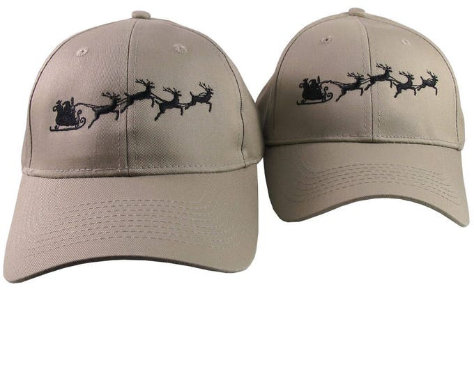 A Pair of Holidays Christmas Santa Sleigh Embroidery Designs on 2 Beige Adjustable Structured Baseball Caps for Adult + for Child Age 6-14
