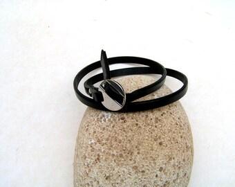 Adjustable black leather bracelet double row.