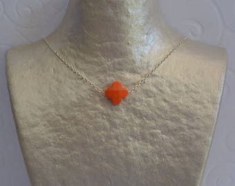 Orange clover necklace and silver chain.