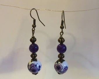 Natural bronze earrings with purple beads and porcelain beads