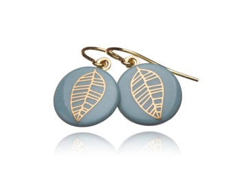 Earring gold leaf on turquoise