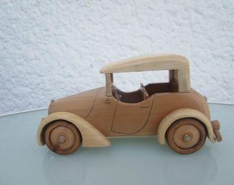 Wooden 4 sedan car seats.