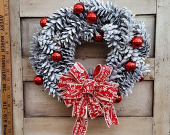 """12"""" White Pine Cone Wreath with Red Accents"""