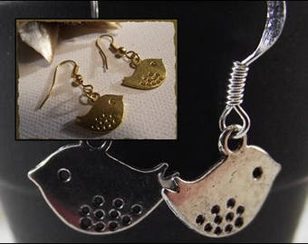 These earrings my little bird look gold or silver metal
