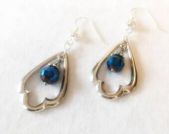 Silver Metal Teardrop Chandelier Earrings with Shimmering Blue Accent Bead on a Silver Earwire