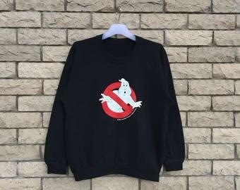 vintage!!! 80's GHOSTBUSTERS sweatshirt spell out big design... Ghostbusters Movie.. copyright 1984.. American comedy.. vintage sweatshirt..