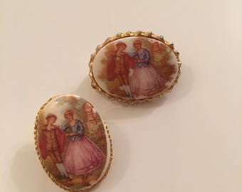 Matching pair of picture brooches