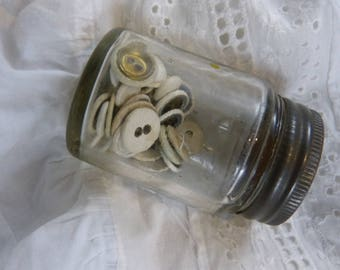 Vintage jar with old cloth covered buttons