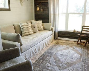 oushak earth toned area rug