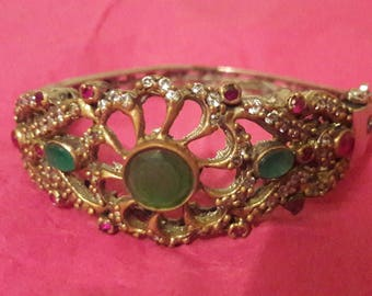 Bracelet with natural stones. Metal with gilding.