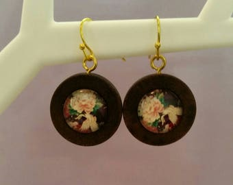 Beautiful pink hues in these glass cabochon earrings.