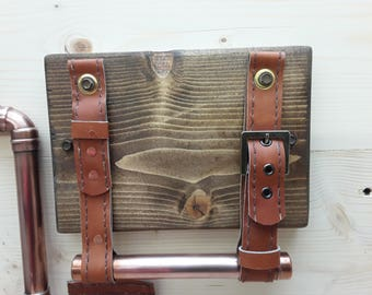 Handmade wood and copper toilet roll holder with hand-stitched leather